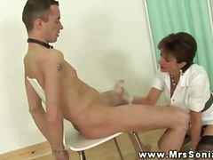 Big titted milf tugs dick and shows a...