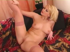 See: Horny blonde strips an...