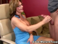 Attractive mature with big tits jerki...