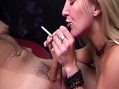 Horny blonde massages the tip of a th...