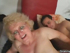 Granny slut sucks and fucks with youn...