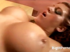 WinPorn Movie:Big boobed redhead spreads for...