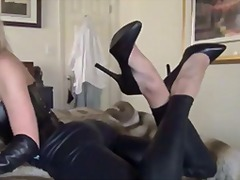 Foot tease in leather leggings and hi...