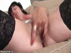 Horny mature brunette woman sucks dildo