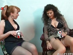Lesbian matures spreading legs to rub...