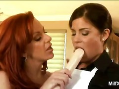 Redhead milf gives les... preview