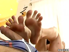 Amy brooke doing a hard foot job on daycouch