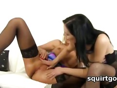 Lesbo squirter gets cunt fucked with glass dildo