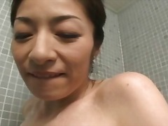 Japanese milf giving a blow job in th...