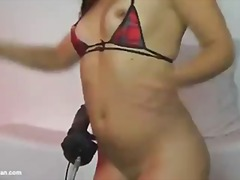 Fucking machine fucks her mouth and pussy