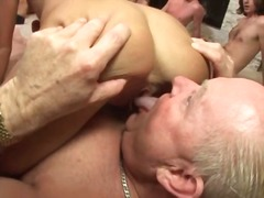 Skinny blonde slut gangbanged by guys in living room