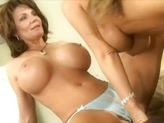 See: Two tasty milfs with g...