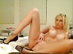 See: Busty blonde babe play...