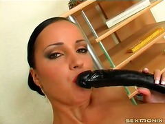 Giant boobs girl with black dildo has...