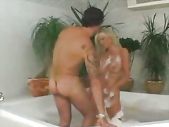 Mature mom smudges her face with cum
