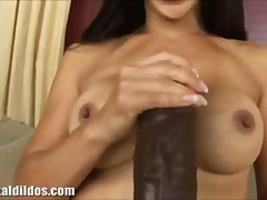 Busty asian babe riding a brutal brown dildo in front of a couch in hd