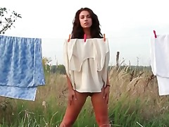 Alpha Porno Movie:Naked girl on a blanket outdoo...
