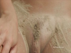 Alpha Porno Movie:Naked girl rubs sand all over ...