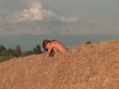 Alpha Porno Movie:Redhead poses on a pile of hay...