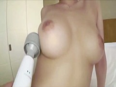 Busty girl fingered nipples and pussy stimulated with vibrator on the bed in the hotel
