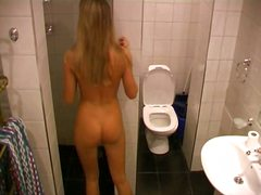 Thumb: Blonde near toilet