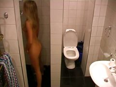 Voyeur Hit Movie:Blonde near toilet