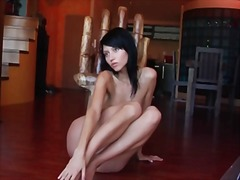 Alpha Porno Movie:Teen in black heels sits with ...