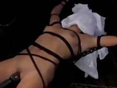 Girl tied to metal cobweb tortured with water pussy stimulated with vibrator by master in the dun...