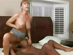 Lesbian redhead caresses and massages black girl sexy hot