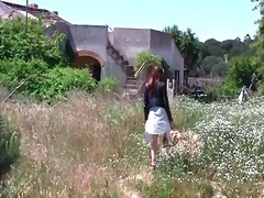 Redhead in skirt and l... video
