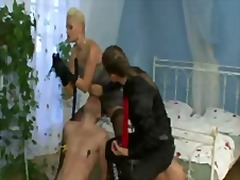 Alpha lesbian femdoms smothering a bound male sissy slave