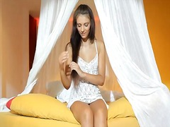 Gal plays with long dildo video