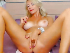Stunning busty blonde ... video