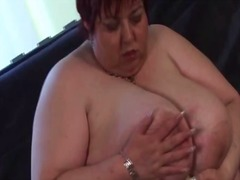 Lusty bbw mature toying her huge tits and fat snatch
