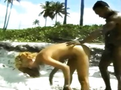 Interracial anal sex on the beach
