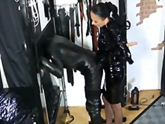 Xhamster Movie:A vinyl domina whips her slave