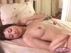 Asian girl licked getting her pussy stimulated with vibrator by busty girl on the bed