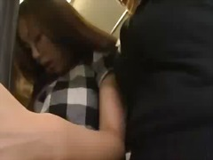 Asian girl by 2 girls on the bus sucking