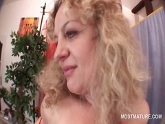 Curly hot mature stripping and finger teasing her snatch