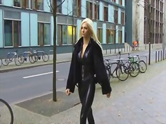 See: Blonde in latex catsui...