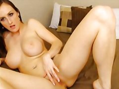 Ashley strips and plays with her pussy