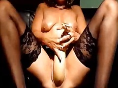 Mature slut fucks a giant dildo whils...