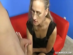 Mature woman jerks a h...