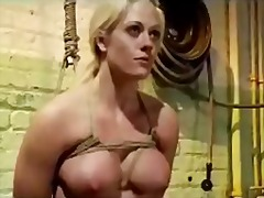 Bondaged blonde girl h...