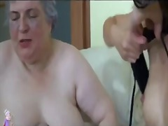 Old busty granny playi...