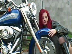 See: Red-haired biker in ex...