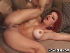 Mature redhead in inte... video