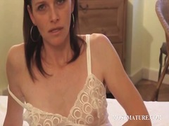 Slim mature playing wi...