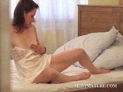 Thumbmail - Slim mature playing wi...