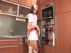 Nurse toying in the ki...